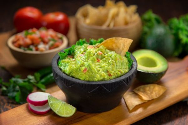A bowl of guacamole and chips
